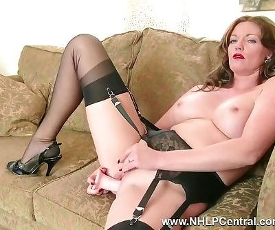 Redhead Milf masturbates in vintage lingerie nylons in kinky dildo session