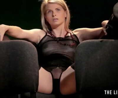 Skinny blonde girl has a really powerful orgasm at the movies