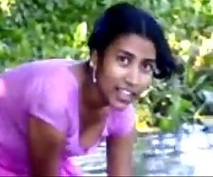 village girl bathing in river..