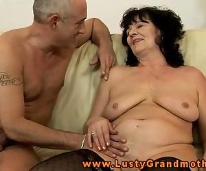 Amateur GILF in stockings takes..