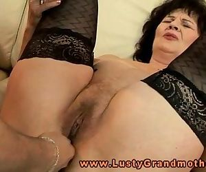 Mature granny in stockings toy..