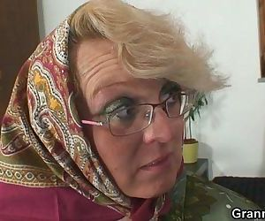 Lonely granny is pleasing an..