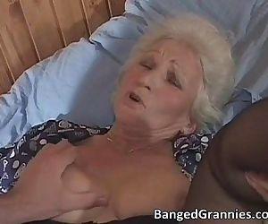 Busty blonde MILF slut sucking..