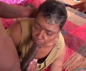 Ebony grandma loves big black..