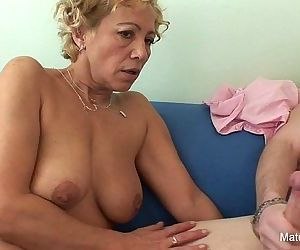 Blonde granny gets cum on her..