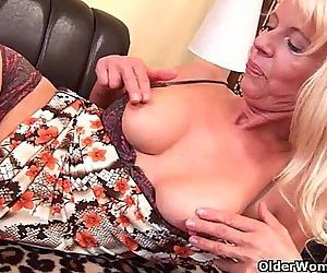 Granny in stockings fucks herself..