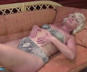 Blonde mature fingering her ass..