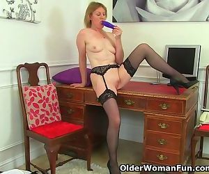British milf Clare strips off her..