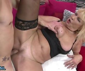 Busty blonde mature riding a cock..