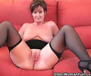 Classy granny in stockings shows..