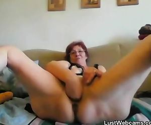 Horny granny fists herself on..