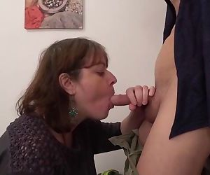 Bossy granny enjoying a young cock