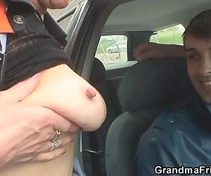 Old bitch takes two cocks outside..