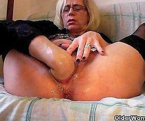 Slutty grandma in stockings fists..