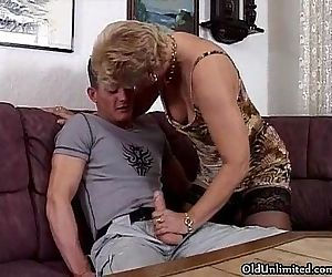Horny blonde granny in stockings..