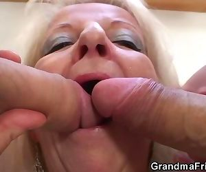 Blonde grandma takes two big..