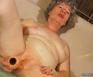 Granny masturbates..