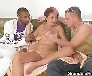 Naughty granny takes two cocks at..