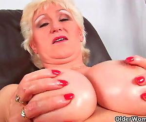 Granny with big tits finger fucks..