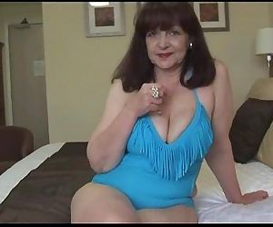 Attractive big tits mature lady..