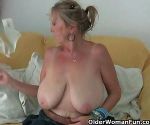 Granny with big tits masturbates..