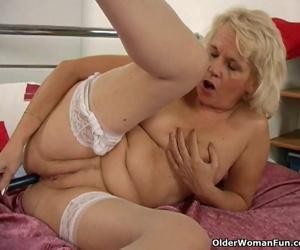 Granny in stockings fucks her..