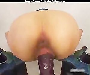 Asian Quivers As She Cums On Huge Dildo asian cumshots..