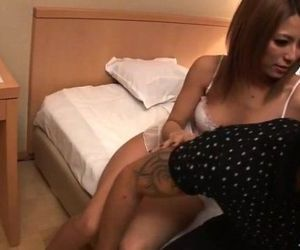 Two busty Japanese dolls fuck a horny guy in a motel room..