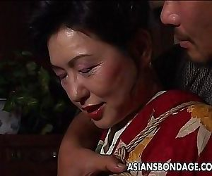 Asian mature bitch has a rope session to endure 8 min