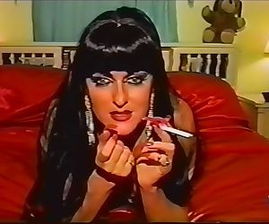 Vintage smoking fetish slut with long red nails & lipstick takes a cumshot