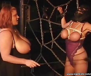Two sluts spanking masked busty whore
