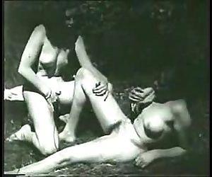 Vintage voyeur watches two lesbians