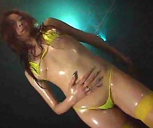 Oiled up asian stripper dancing