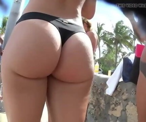 Beautiful Girls on the Beach Exposing their Big Juicy Ass in Wet Bikinis !