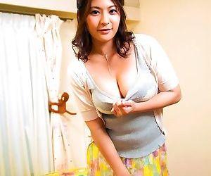 Big breasted asian porn star meguri posing in her bedroom..