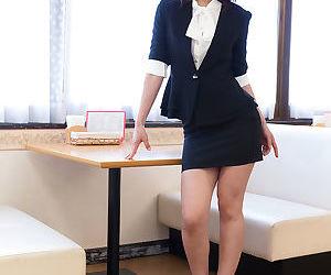 Cute Japanese teen schoolgirl in uniform licks cock in..