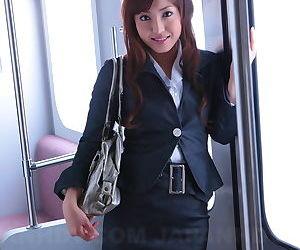 Gorgeous Japanese girl Mami Asakura opens her shirt to..