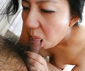 Saucy asian mature slut gives head and gets her shaggy..