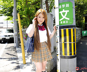 Innocent Japanese schoolgirl Ria Sakurai flashes sexy..