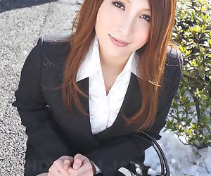 Hot redhead Japanese girl in suit poses to show her..
