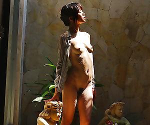 Sexy asian babe Saki Ninomiya showcasing her perky tits..