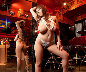 Japanese bombshell Hitomi exposing her giant breasts in..
