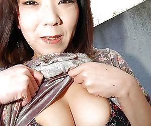 Mature asian slut Yoriko Akiyoshi strips down and enjoys..