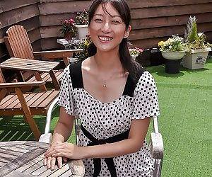 Asian MILF Miki Sugimoto rubs her slit under her panties..