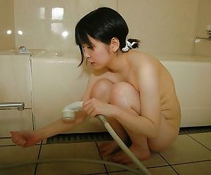 Sassy asian teen taking shower and rubbing her slit in..