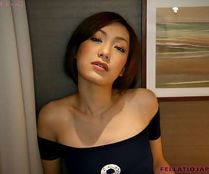 Petite Japanese girl Iino Nene gives a blowjob on her knees