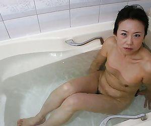 Mature asian lassie Junko Sakashita exposing her pink twat..