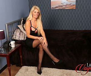 Big mouth blonde Dawn Riley undressing to get surprised by..