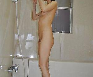 Asian MILF Mayumi Iihara taking shower and teasing her..
