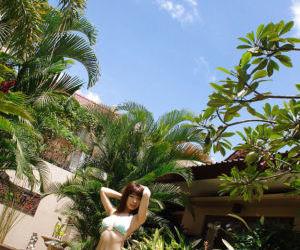Cute asian babe Hikari Hino slipping off her bikini top..